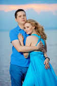 Couple in love on the beach. Beauty young woman and man at the s — Stock Photo