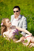 Happy young adult couple in love on the field. Two,  man and wom — Stock Photo