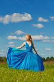 Luxury beautiful woman in long evening fashionable dress outdoor — Stock Photo