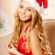 Young beautiful smiling santa woman near the Christmas tree. Gir — Stock Photo #46349819