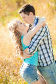 Happy young adult couple in love on the field. Two,  man and wom — Stockfoto