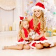 Mother and daughter dressed as Santa celebrate Christmas. Family — Stock Photo #46350083