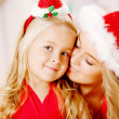 Mother and daughter dressed as Santa celebrate Christmas. Family — Stock Photo #46350093