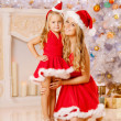 Mother and daughter dressed as Santa celebrate Christmas. Family — Stock Photo #46350115