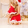 Mom and daughter dressed as Santa celebrate Christmas. Family at — Stock Photo