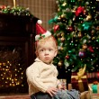Baby near the Christmas tree. Little boy celebrating Christmas. — Stock Photo #46350437