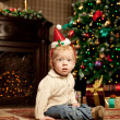 Baby near the Christmas tree. Little boy celebrating Christmas. — Stock Photo #46350445
