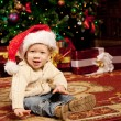 Baby near the Christmas tree. Little boy celebrating Christmas. — Stock Photo #46350461