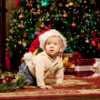 Baby near the Christmas tree. Little boy celebrating Christmas. — Stock Photo