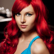 Young woman with luxurious long beautiful red hair in a blue fas — Photo