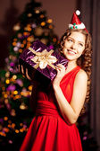 Beautiful young santa girl. Luxury richest woman in the Christma — Stock Photo