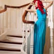 Young smiling woman with luxurious long beautiful red haired. Gi — Photo