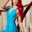 Young woman with luxurious long beautiful red hair in a blue fas — Stok fotoğraf #48564201