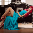 Young woman with luxurious long beautiful red hair in a blue fas — Stok fotoğraf #48564269