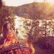 Beautiful witch in the woods near the fire. Magic woman celebrat — Stock Photo #48564371