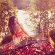 Beauty witch in the woods near the fire. Magic woman celebrating — Stock Photo #48564391