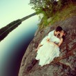 Loving couple hugging on the lake. Beauty young woman and man in — Stock Photo #48564635