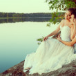 Loving couple hugging on the lake. Beauty young woman and man in — Stock Photo #48564755