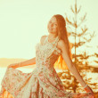 Luxury woman in a forest in a long vintage dress near the lake. — Stock Photo #48565285