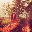 Beautiful witch in the woods near the fire. Magic woman celebrat — Stock Photo #48566047