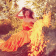 Beauty witch in the woods near the fire. Magic woman celebrating — Stock Photo #48566049