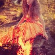 Beauty witch in the woods near the fire. Magic woman celebrating — Stock Photo #48566051