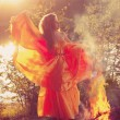 Beauty witch in the woods near the fire. Magic woman celebrating — Stock Photo #48566111