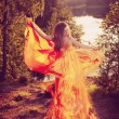 Beauty witch in the woods near the fire. Magic woman celebrating — Stock Photo #48566135