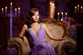 Luxury fashion stylish woman in the rich interior. Beautiful gir — Stock Photo