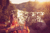 Beautiful witch in the woods near the fire. Magic woman celebrat — Stock Photo