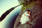 Loving couple hugging on the lake. Beauty young woman and man in — Stock Photo