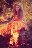 Beauty witch in the woods near the fire. Magic woman celebrating — Stock Photo