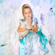 Little girl in princess dress on a background of a winter fairy — Stock Photo #51084407
