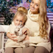 Winter mother and daughter. Smiling woman and child. Cute girl w — Stock Photo #51084691