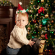 Nice baby near the Christmas tree. Little boy celebrating Christ — Stock Photo #51084871