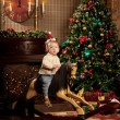 Nice baby near the Christmas tree. Little boy celebrating Christ — Stock Photo #51084903