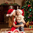 Happy smiling family near the Christmas tree celebrate New Year. — Stock Photo