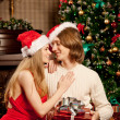 Nice love couple near the Christmas tree. Woman and man celebrat — Stock Photo #51085029