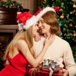 Nice young love couple near the Christmas tree. Woman and man ce — Stock Photo #51085041
