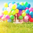 Happy birthday woman against the sky with rainbow-colored air ba — Stock Photo #51085137