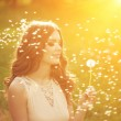 Beautiful young woman blowing  dandelion. Trendy young girl at s — Stock Photo #51085277