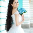 Bride with flowers — Stock Photo #51085629