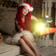 Young beautiful smiling santa woman. Christmas Fashionable luxur — Stock Photo #51087253