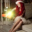 Young beautiful smiling santa woman. Christmas Fashionable luxur — Stock Photo #51087265