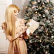 Luxury blonde in interior New Year. Young beauty trendy girl cel — Stock Photo #51087317