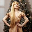 Luxury blonde in interior New Year. Young beauty trendy girl cel — Stock Photo #51087339