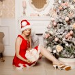 Young beautiful smiling santa woman near the Christmas tree. Fas — Stock Photo #51087645
