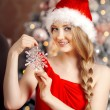 Young beautiful smiling santa woman near the Christmas tree. Fas — Stock Photo #51087685