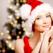 Young beautiful smiling santa woman near the Christmas tree. Fas — Stock Photo #51087731