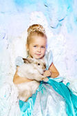 Little girl in princess dress on a background of a winter fairy  — Stock Photo